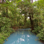 The charm of Rio Celeste is its turquoise color. Surrounded by lush vegetation, this natural river seems to pop out of a fairytale